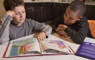 Boys reading puppy mill education materials
