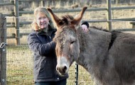 Portrait of Robin Mock and adopted burro Samson