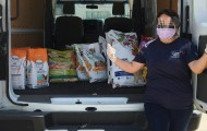 Pets for Life staff member with a van full of supplies