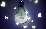 Photo illustration of a dim light bulb with illustrated butterflies