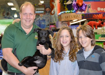Pennsylvania state senator Daylin Leach and his family meet an adoptable pooch at the grand re-opening of Pets Plus in Conshohocken, Penn.