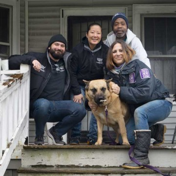 Pets for Life team with client in Detroit on front porch