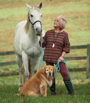 Tanya Tucker with her horse and dog