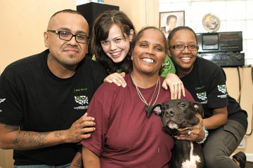 Portrait of PFL employees and care recipient and dog
