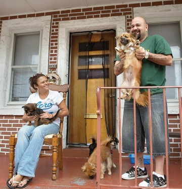 Ramos with his dogs and wife on porch