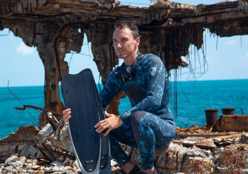 Rob Stewart, filmmaker, in his wetsuit between filming of Sharkwater Extinction