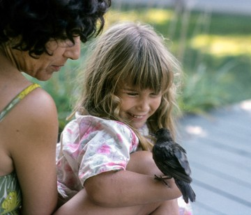 Kitty Block and her mother when she was a child, holding a bird