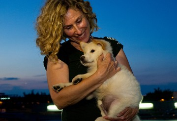 Kitty Block, Acting President and CEO, with a rescue dog from a China dog meat farm