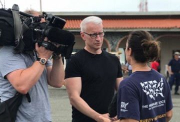 Anderson Cooper interviewing HSUS staff member after transport of animals displaced by Hurricane Maria