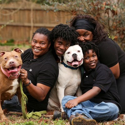 Tika Johnson, right, and Sharonda Byrd, left, pose for a photo with their dogs, Treasure and Fat Daddy, and their sons, Dre and Trae